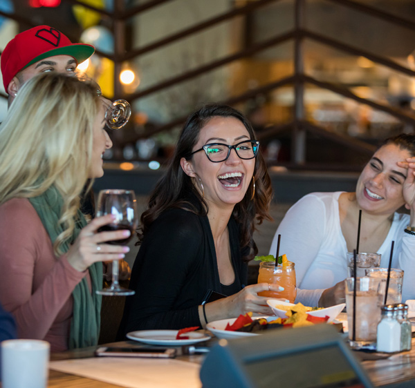 Three friends at the bar laughing