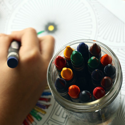 Child's hand drawing with a crayon