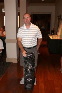 man holding golf equipment