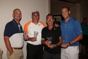men holding trophies